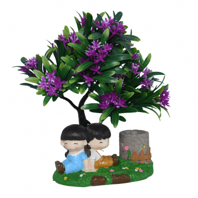 Show Piece boy and girl in garden under tree