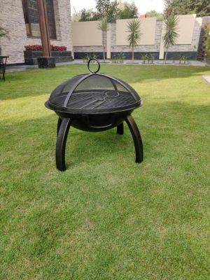 BKR Firepit Round With Skewers For Barbecuing